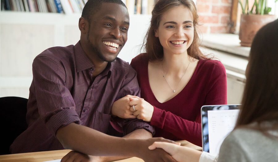 couple signing term life contract