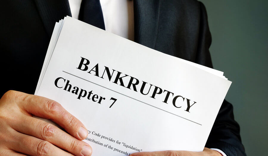 man holding bankruptcy chapter 7