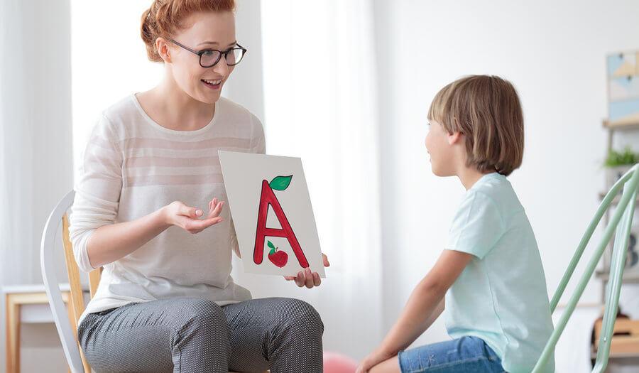 speech language pathologist with a child