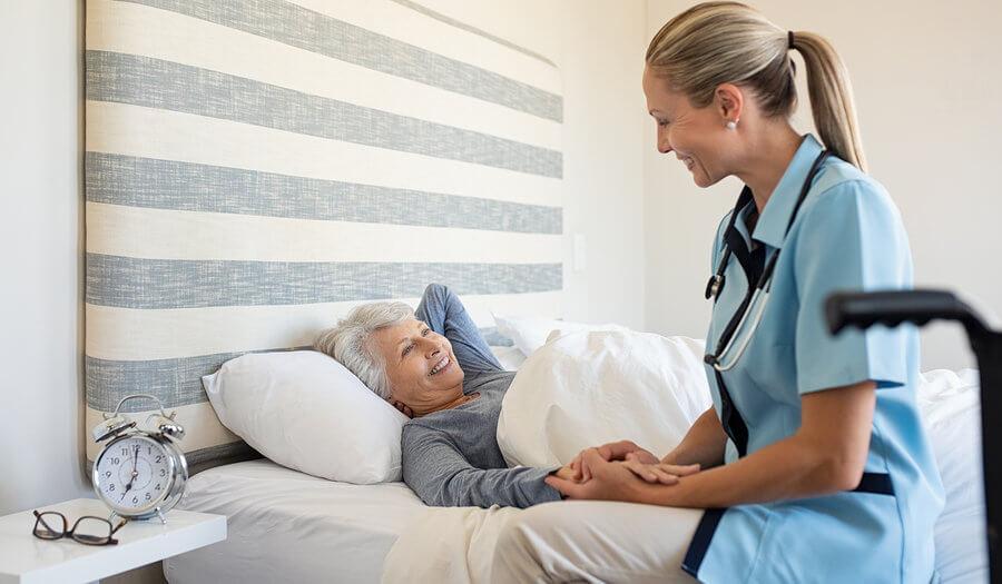nurse practitioner holding a patient hand