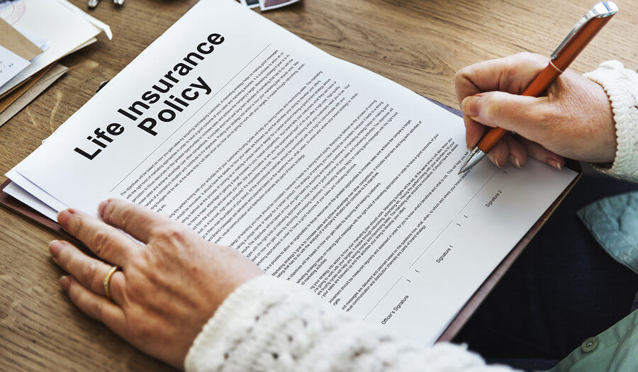 elderly signing insurance policy