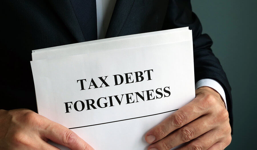 man holding tax debt forgiveness