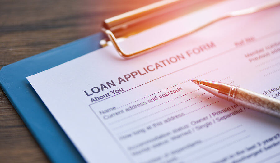 loan application form with a pen