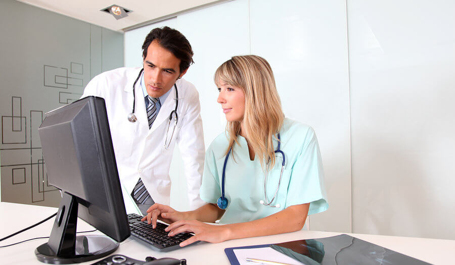 a medical coder lady with the doctor
