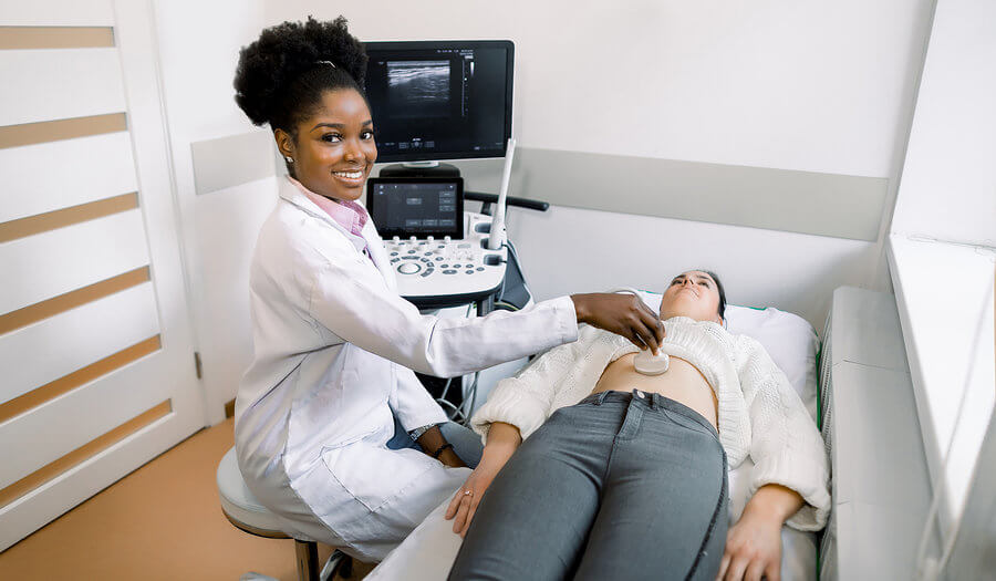 black woman using ultrasound equipment